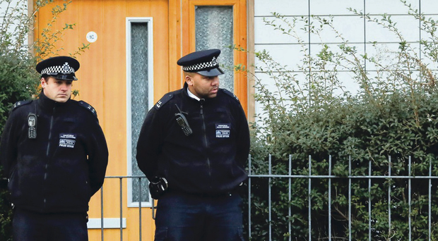 Police officers on guard outside the flat where Josephine was allegedly held for years as a slave