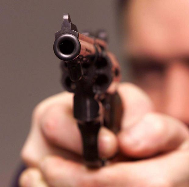 As the muggers were taking the man's valuables, including a mobile phone, one of them pulled a handgun and shot at him
