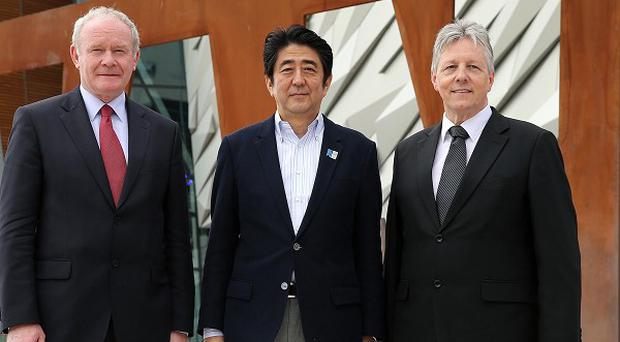 Martin McGuinness (left) and Peter Robinson (right) met Japanese prime minister Shinzo Abe (centre) at the G8 summit