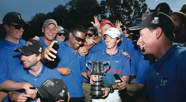 Rory McIlroy celebrates his first victory of 2013 at the Australian Open with groundstaff at the Royal Sydney Golf Club