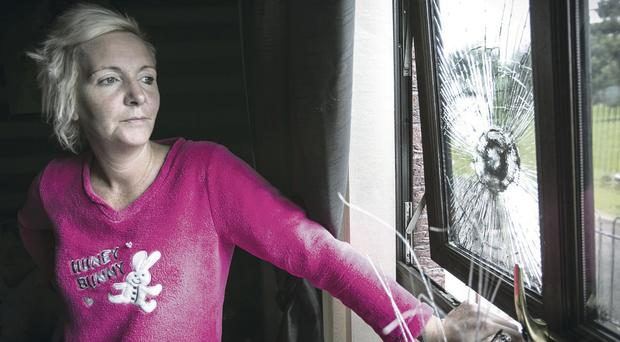 Tracey Coulter at her home after an attack by loyalists earlier this year