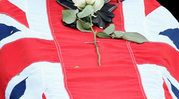 The coffin of murdered prison officer David Black.