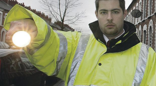 Residents would like to see community wardens like Chris Leech, seen here on patrol in the Holyland area of Belfast in 2006, reinstated