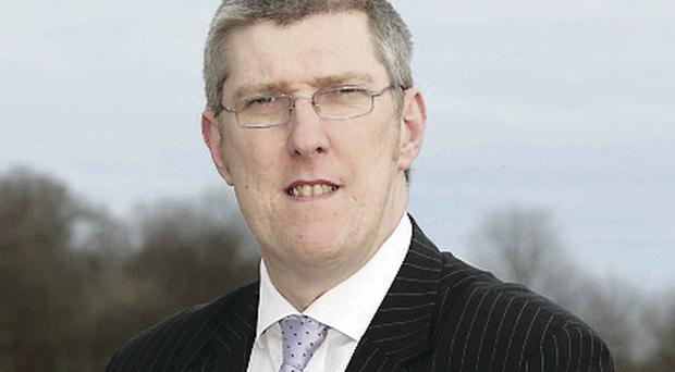 Education Minister John O'Dowd: system must be re-considered
