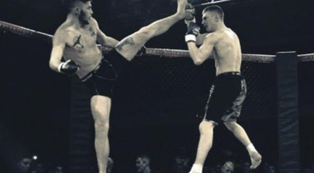 Carl McNally fighting in the Mixed Martial Arts Federation of Ireland's first Ulster final