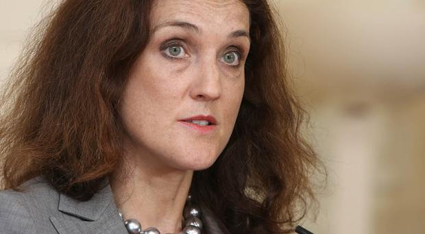Secretary of State for Northern Ireland Theresa Villiers says greater efforts are needed to revive the local economy.
