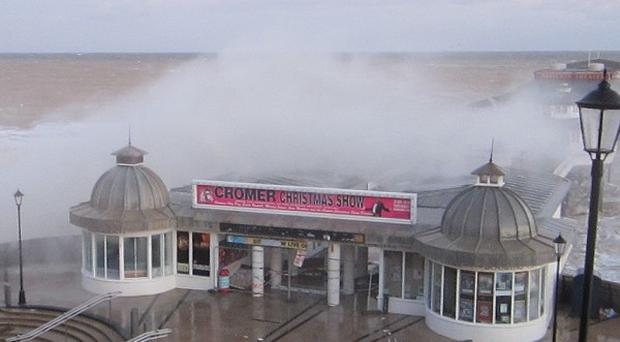 Cromer Pier the morning after the worst tidal surge for more than 60 years hit coastal towns along the east coast of Britain