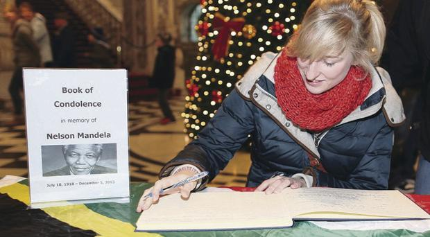 Monika Heisterklaus from Germany signs the book of condolence for Nelson Mandela in Belfast City Hall