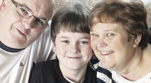Thirteen year-old Matthew Cully with his parents Carol and David