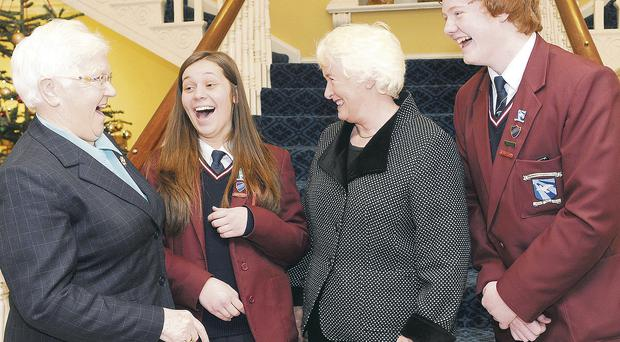 Margaret Mountford (second right) with Baroness May Blood and Hazelwood Integrated College head girl Courtney Laight and head boy