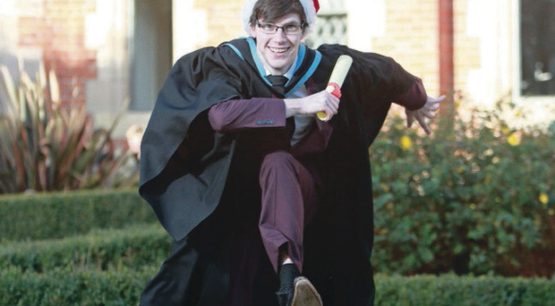 Damian McIlroy, from Glengormley, is jumping for joy at the Queen's University Belfast
