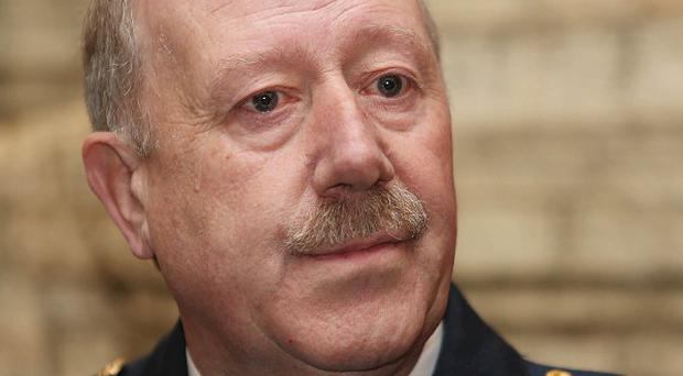 The Garda Commissioner Martin Callinan has questioned one of the findings of the Smithwick Tribunal.