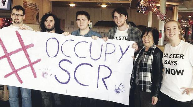 Assembly Member Anna Lo joins protesting students inside the common room they are trying to save