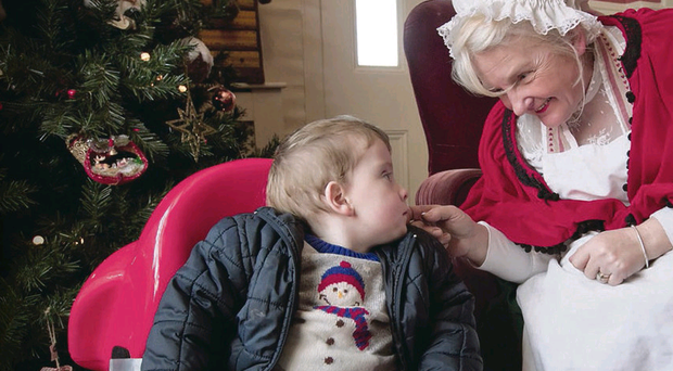 Anthony with Mrs Claus, aka Rosemary McCook, at Santa's Gatelodge in Milford