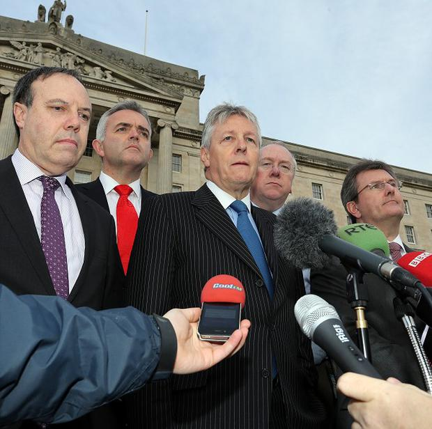 DUP leader and First Minister Peter Robinson speaks to the media at Stormont
