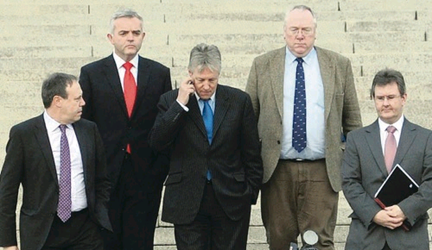 First Minister Peter Robinson speaks to the media with his DUP party colleagues at Stormont after the five main Stormont parties had been examining the document drafted by US diplomat Richard Haas