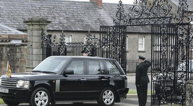 The Queen drives through the 'misplaced' Hillsborough Castle gates