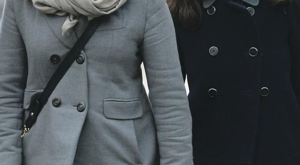 Sisters Elisabetta (left) and Francesca Grillo deny fraudulent use of a credit card