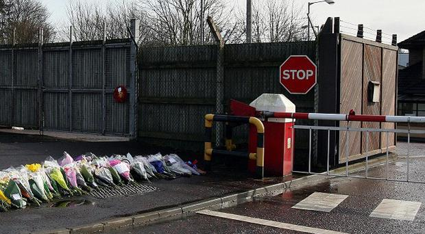 Flowers left at the gates of Massereene barracks after the two soldiers were shot dead outside the base.