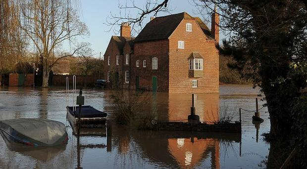 Cropthorne Mill is surrounded by floodwater from the River Avon in Fladbury, Worcestershire.