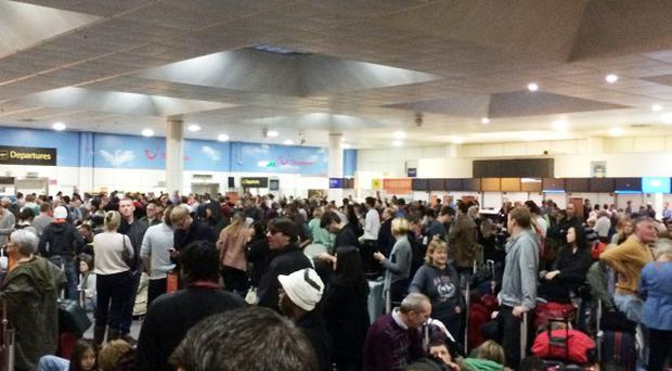 Passengers waiting at the North Terminal at Gatwick Airport after a power cut at the airport's North Terminal led to delays. Picture by Daniel Cawthorne.