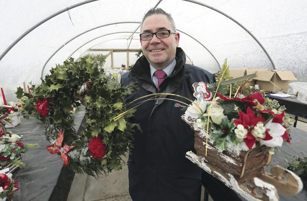 Austin Treacy, Deputy Governor of Maghaberry Prison, with some of the festive wreaths which have been made by prisoners