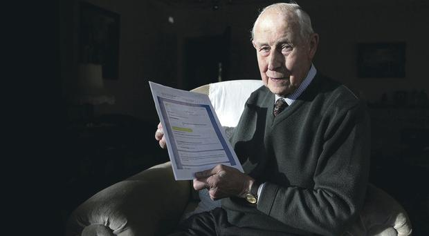 Traumatised: Widower Leslie Neill with the Airtricity bill