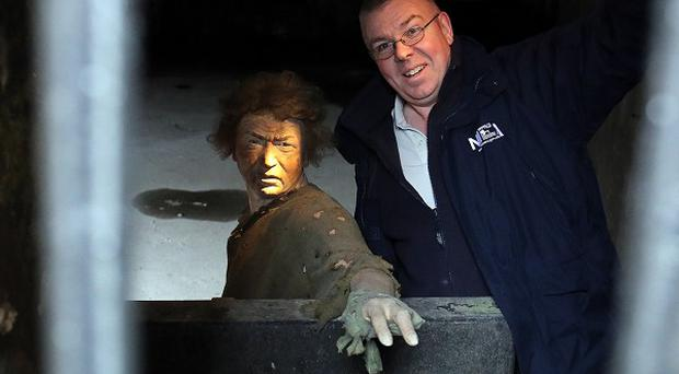 Phillip McConnell inside the dungeons at Carrickfergus Castle in Co Antrim, which are to be opened up to the public.