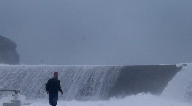 Emergency services are searching for people missing in ferocious weather amid the first storms of 2014