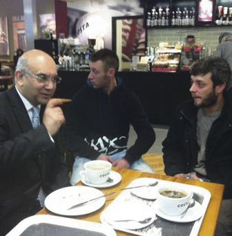 Keith Vaz MP greets arrivals at Luton Airport, including Victor Spiresau (right), as the first Romanians and Bulgarians with unrestricted access to the UK jobs market began to land yesterday