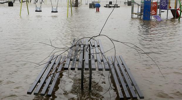 A children's play park covered by flood waters on the Racecourse Sportsground in Tonbridge, Kent.