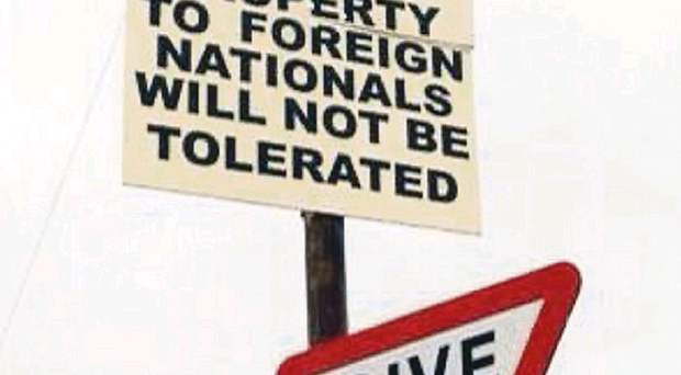 The threatening sign, put up in Moygashel on New Year's Eve, angered residents. Pictured by Emma Grey