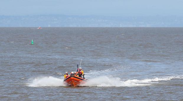 Police, Coastguard, the RNLI and helicopters from the police and RNAS Culdrose are conducting extensive searches for a missing 18-year-old