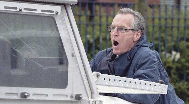 Sinn Fein's Gerry Kelly on the front of a PSNI Land Rover during last summer's marching season