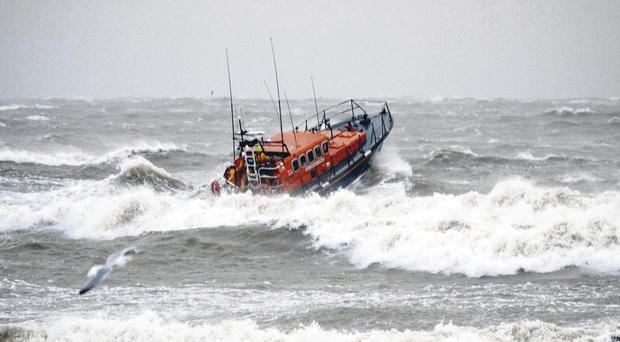 Newcastle's all-weather and inshore lifeboats battle through rough seas.