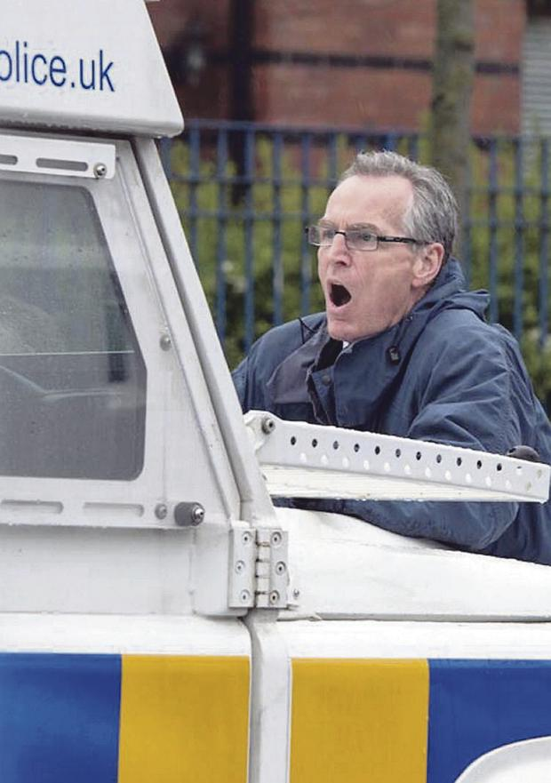 Sinn Fein MLA Gerry Kelly on the police Land Rover in June