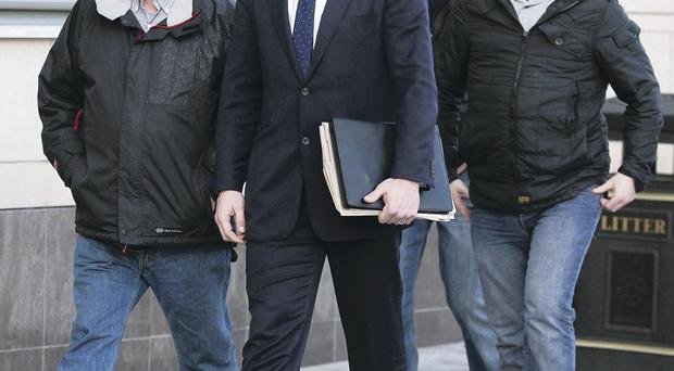 Joe Convie, father of Gary Convie, and solicitor Paddy Murray along with Dermot and Kieran Fox, sons of Eamon Fox, leaving Belfast Laganside Courts