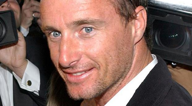 Former Formula One racing driver Eddie Irvine has been handed a prison sentence in Italy