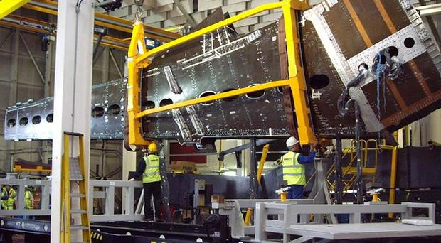 Work being carried out on the pre-production demonstrator wing for the CSeries aircraft.