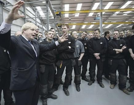 London mayor Boris Johnson talks to staff at Wrightbus factories in Ballymena and Antrim during a tour of the new premises in April 2013