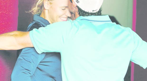 Rory McIlroy kisses the forehead Caroline Wozniacki