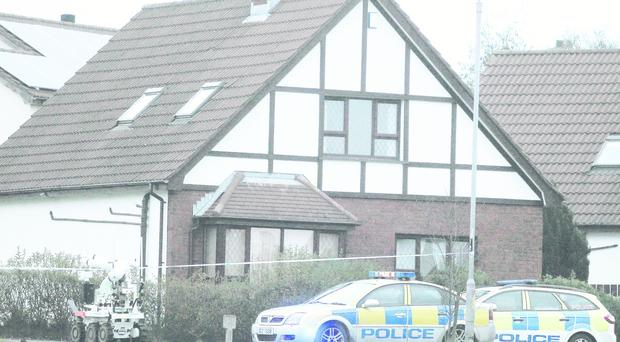 Police and army technical experts deal with a suspicious package at Broadlands Gardens in Carrickfergus