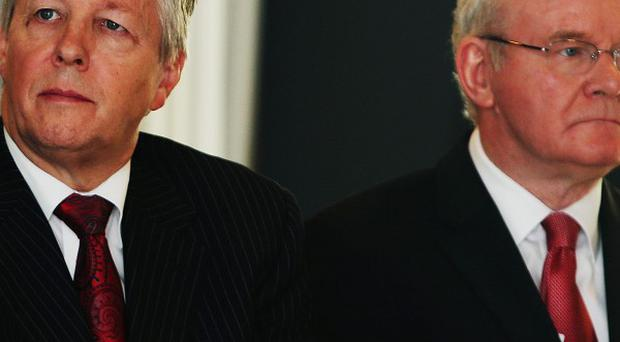 Peter Robinson (left) and Martin McGuinness have clashed over the Haass talks.