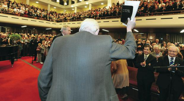Ian Paisley waves to the congregation after his special farewell service at Martyrs Memorial Church in 2012