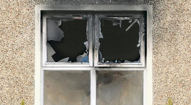 The damaged house in Coalisland after a petrol bomb attack