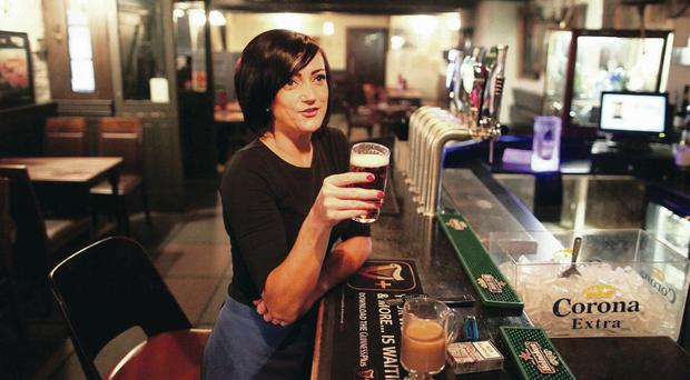 Marguerita Sloan with a pint of beer in White's Tavern yesterday. Pic David Fitzgerald