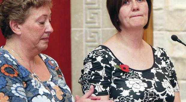 Neil McFerran's mother Catherine (right) and Aaron Davidson's mother Katrina speaking at the launch in Stormont of a campaign highlighting the dangers of carbon monoxide four months after their sons' deaths in 2010