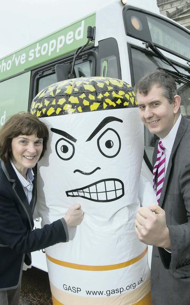 Hop on board: Gerry Bleakney from the Public Health Agency (PHA) and Health Minister Edwin Poots launch the PHA's new stop smoking bus