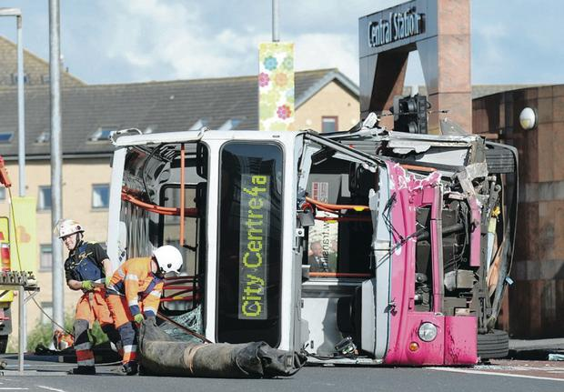 Firefighters at the scene of the double-decker bus crash outside Belfast's Central Station in 2011