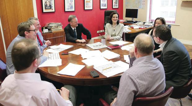 Secretary of State Theresa Villiers sits in on a news conference at the Belfast Telegraph with editor Mike Gilson (centre) and other staff